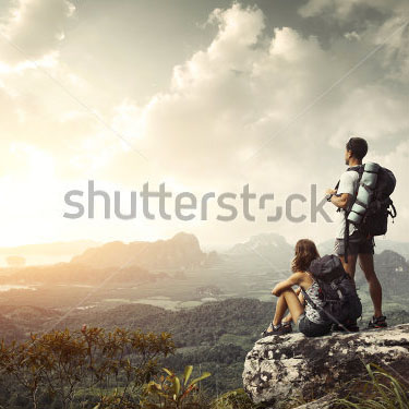 stock-photo-hikers-with-backpacks-enjoying-valley-view-from-top-of-a-mountain-115313584new