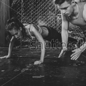 stock-photo-sportsmen-fit-male-trainer-man-and-woman-doing-clapping-push-ups-explosive-strength-training-272645438new