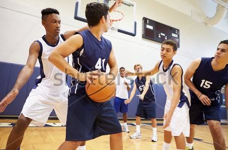 stock-photo-male-high-school-basketball-team-playing-game-199288139